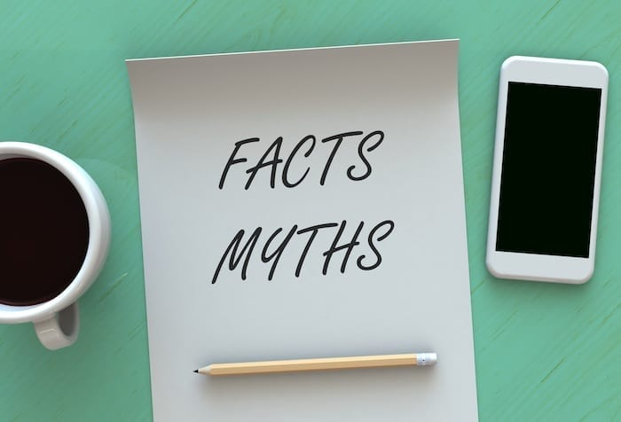 Facts Myths, message on paper, smart phone and coffee on table, 3D rendering